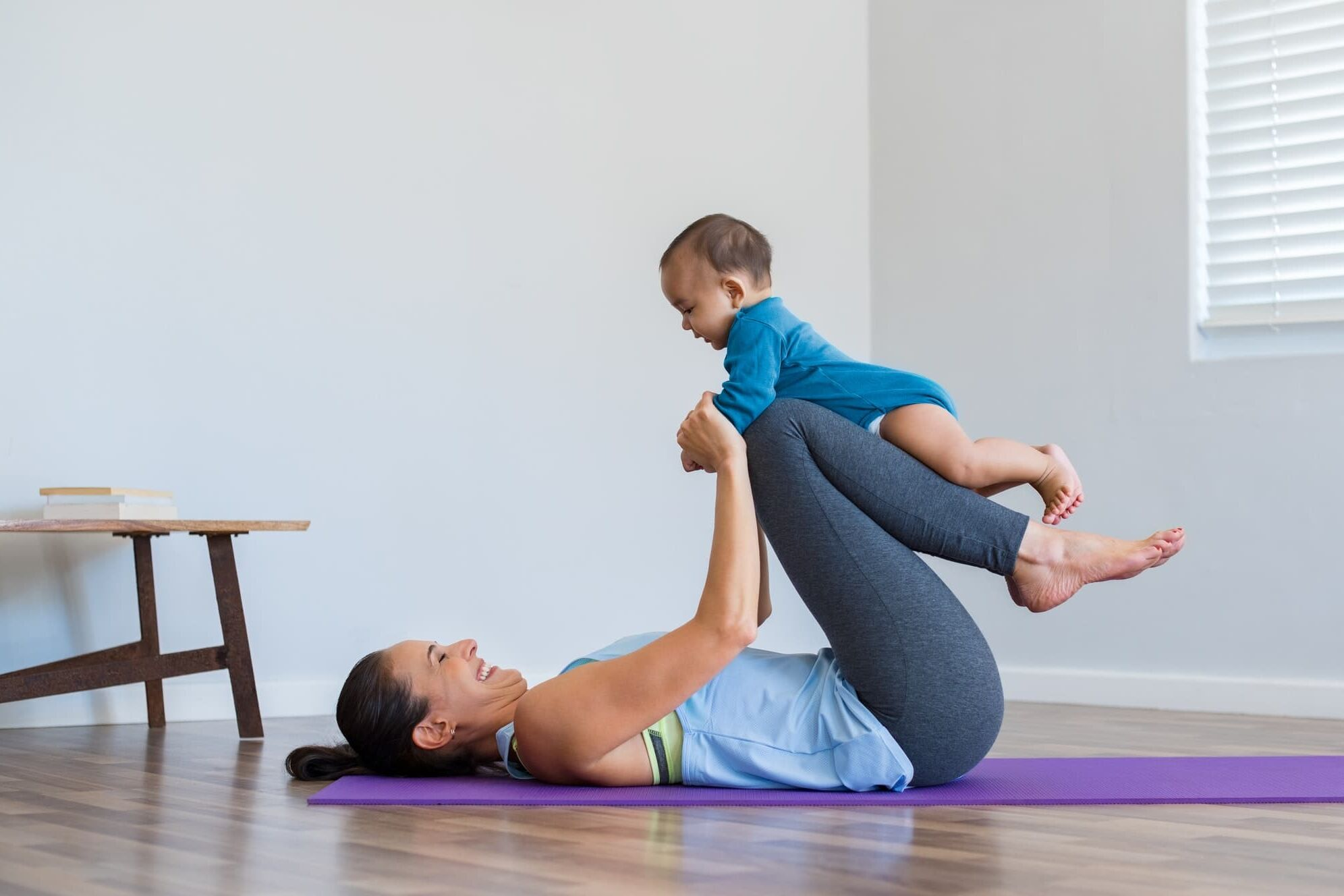 Mother and little son exercising